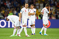 Football - European Championships 2012 - England vs. Italy<br /> John Terry and Steven Gerrard of England are left looking dejected following defeat on penalties  at the Olympic Stadium, Kiev