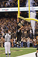 NEW ORLEANS, LA - DECEMBER 26:   Jimmy Graham #80 of the New Orleans Saints dunks the football over the goal post after catching a touchdown pass against the Atlanta Falcons at Mercedes-Benz Superdome on December 26, 2011 in New Orleans, Louisiana.  The Saints defeated the Falcons 45-16.  (Photo by Wesley Hitt/Getty Images) *** Local Caption *** Jimmy Graham Sports photography by Wesley Hitt photography with images from the NFL, NCAA and Arkansas Razorbacks.  Hitt photography in based in Fayetteville, Arkansas where he shoots Commercial Photography, Editorial Photography, Advertising Photography, Stock Photography and People Photography