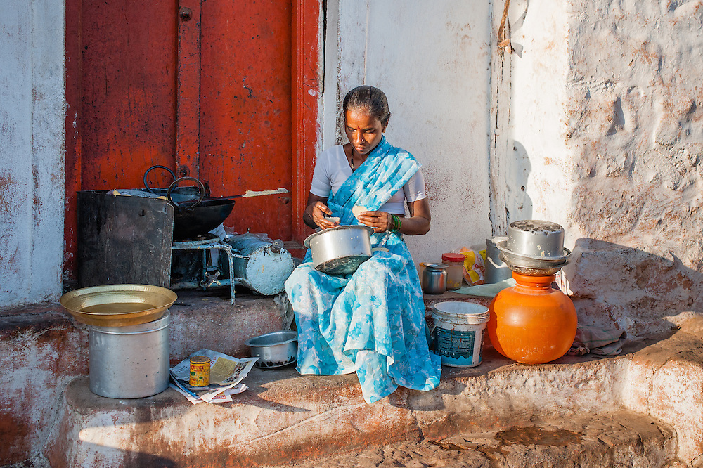 Woman in sari cooking outdoors (India)