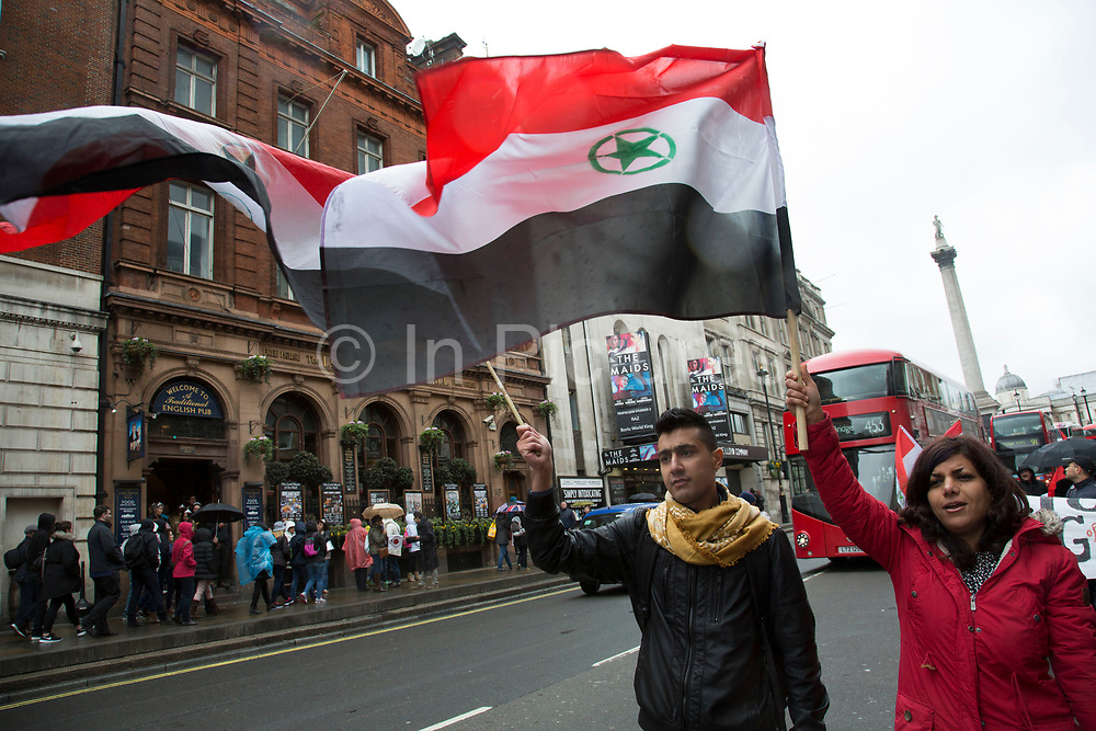 Demonstrators walk along Whitehall carrying the flag of Al-Ahwaz Liberation Organization, and protesting against the treatment of Ahwazis by Iran on April 11 2016 in London, United Kingdom. The protest called for a stop to ethnic cleansing of Arab political prisoners.