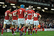Alex Cuthbert of Wales  celebrates with Justin Tupuric (7) after he scores his 2nd try.RBS Six nations championship 2013, Wales v England at the Millennium stadium in Cardiff , South Wales on Saturday 16th March 2013. pic by Andrew Orchard, Andrew Orchard sports photography,