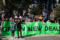 London, UK. 24th September, 2021. Asad Rehman, Executive Director of War on Want, addresses hundreds of young people taking part in a Global Climate Strike to demand intersectional climate justice. The Global Climate Strike was organised to highlight the detrimental influences through colonialism, imperialism and exploitation of the Global North on MAPA (Most Affected Peoples and Areas), which have contributed to them now experiencing the worst impacts of the climate crisis, and to call on the Global North to pay reparations to MAPA.
