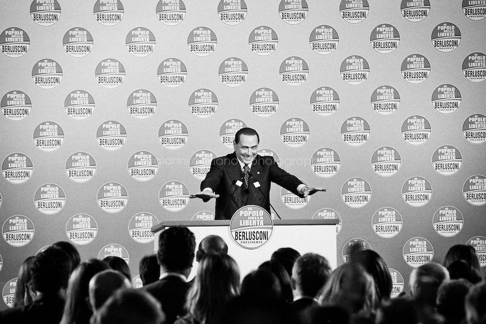 """ROME, ITALY - 24 JANUARY 2013: Silvio Berlusconi, former PM and leader of The People of Freedom party, talks to his candidates for the upcoming general elections during a convention in Rome, on January 25, 2013.<br /> <br /> A general election to determine the 630 members of the Chamber of Deputies and the 315 elective members of the Senate, the two houses of the Italian parliament, will take place on 24–25 February 2013. The main candidates running for Prime Minister are Pierluigi Bersani (leader of the centre-left coalition """"Italy. Common Good""""), former PM Mario Monti (leader of the centrist coalition """"With Monti for Italy"""") and former PM Silvio Berlusconi (leader of the centre-right coalition).<br /> <br /> ###<br /> <br /> ROMA, ITALIA - 24 GENNAIO 2013: Silvio Berlusconi, ex-premier e leader del Popolo della Libertà, si rivolge ai suoi candidati PdL alle prossime elezioni politiche, durante una convention a Roma il 24 gennaio 2013.<br /> <br /> Le elezioni politiche italiane del 2013 per il rinnovo dei due rami del Parlamento italiano – la Camera dei deputati e il Senato della Repubblica – si terranno domenica 24 e lunedì 25 febbraio 2013 a seguito dello scioglimento anticipato delle Camere avvenuto il 22 dicembre 2012, quattro mesi prima della conclusione naturale della XVI Legislatura. I principali candidate per la Presidenza del Consiglio sono Pierluigi Bersani (leader della coalizione di centro-sinistra """"Italia. Bene Comune""""), il premier uscente Mario Monti (leader della coalizione di centro """"Con Monti per l'Italia"""") e l'ex-premier Silvio Berlusconi (leader della coalizione di centro-destra).ROME, ITALY - 24 JANUARY 2013: Silvio Berlusconi, former PM and leader of The People of Freedom party, and Angelino Alfano, Secretary of the party, present the PdL candidates for the upcoming general elections during the PdL convention in Rome, on January 25, 2013.<br /> <br /> A general election to determine the 630 members of the Chamber of Deputies and the 315 electi"""