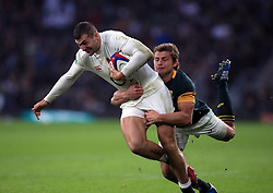 England's George Ford scores his side's third try during the Autumn International match at Twickenham Stadium, London.