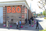 Customers queue outside the Old Kent Road branch of B&Q on Tuesday afternoon, May 5, 2020 - following the social distance rules after the DIY retailer reopened all 288 of its retail stores across UK, amid the coronavirus lockdown. (Photo/Vudi Xhymshiti)
