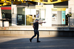 © Licensed to London News Pictures. 26/03/2020. Manchester, UK. Police respond to reports of a mobile phone theft outside the Arndale Centre . Manchester City Centre lies nearly empty during a sunny spring afternoon . The British government has imposed a lockdown on all but essential activities and instructed people to reduce social contact as part of quarantine measures to prevent the spread of Coronavirus ( COVID-19 ) . Photo credit: Joel Goodman/LNP