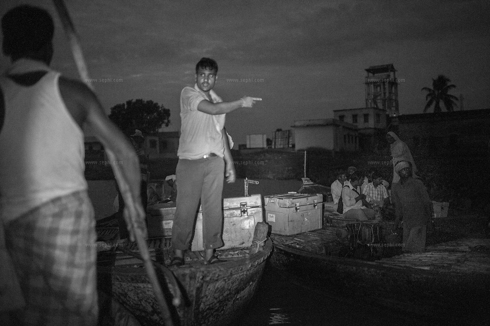 4:54am. The cold boxes contatining the polio vaccine are loaded onto the boats at Kusheshwar Asthan east, Bihar.