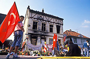 In the town of Solingen, Germany on the night of 28th May 1993 four German youths set fire to the home of the Turkish Genç family. Five family members, including three children, died and became worldwide symbols for victims of racism. Here people pay their respects with laying of flowers and Turkish flags in solidarity to the victims.
