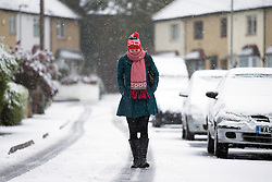 © Licensed to London News Pictures. 09/11/2016. Leeds UK. A woman walks to work in the snow this morning as heavy snow fell in Leeds. Photo credit: Andrew McCaren/LNP