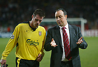 23/11/2004 - UEFA Champions League - Group A - AS Monaco v Liverpool  - Stade Louis II, Monte Carlo<br />Liverpool coach Rafael Benitez talks tactics with defender Jamie Carragher as they walk off the pitch.<br />Photo:Jed Leicester/Back Page Images
