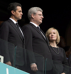 Dec. 10, 2013 - Johannesburg, South Africa - Canadian Prime Minister Stephen Harper and his wife Laureen stand next to Mexican President Enrique Pena Nieto Tuesday December 10, 2013 in Johannesburg, South Africa, during the memorial to Nelson Mandela. THE CANADIAN PRESS/Adrian Wyld (Credit Image: © Adrian Wyld/The Canadian Press/ZUMAPRESS.com)
