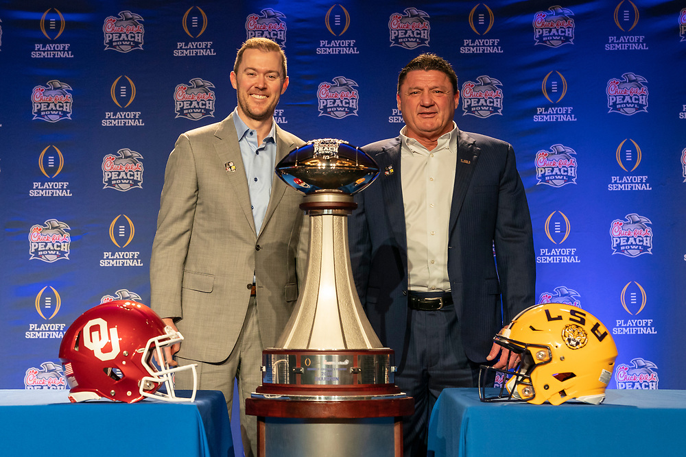 Oklahoma Sooners head coach Lincoln Riley and LSU Tigers head coach Ed Orgeron pose for a photo following their joint head coaches news conference on Friday, Dec. 27, in Atlanta. #4 Oklahoma will face #1 LSU in the 2019 College Football Playoff Semifinal at the Chick-fil-A Peach Bowl on Saturday, Dec. 28, 2019. (Paul Abell via Abell Images for the Chick-fil-A Peach Bowl)