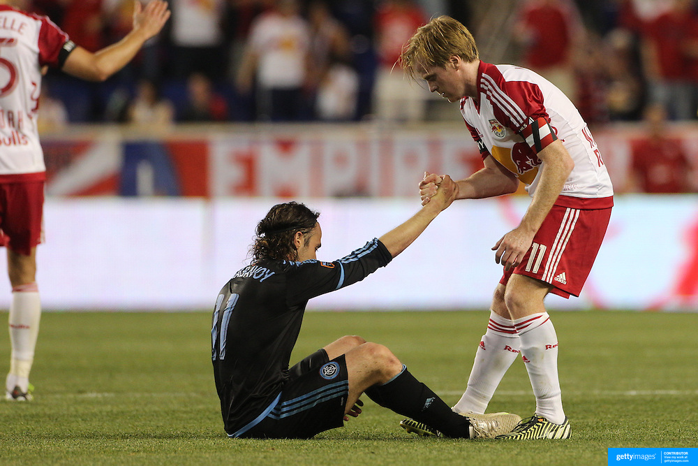 A touching moment at the end of the game as Dax McCarty, (right), New York Red Bulls, consoles his opposite number Ned Grabavoy after the New York Red Bulls 2-1 victory  during the New York Red Bulls Vs NYCFC, MLS regular season match at Red Bull Arena, Harrison, New Jersey. USA. 10th May 2015. Photo Tim Clayton