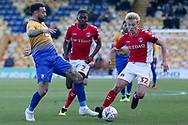 Craig Davies of Mansfield Town (9), George Lapslie of Charlton Athletic (32) and Anfernee Dijksteel of Charlton Athletic (2) battle for the ball during the The FA Cup match between Mansfield Town and Charlton Athletic at the One Call Stadium, Mansfield, England on 11 November 2018.