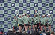 London,  England, Great Britain, 7th April 2019, CUWBC President Abagail PARKER, with the Trophy celebrates with the Blue Boat Crew after winning the 2019  Oxford and Cambridge Universities Men's Varsity, Boat Race, Crew: Trica SMITH, <br /> Sophie DEANS,<br /> Laura FOSTER, <br /> Larkin SAYRE, <br /> Kate HORVAT, <br /> Pippa WHITTAKER, <br /> Ida Gerte JACOBSEN, <br /> Lily LINDSAY<br /> Cox, Hugh SPAUGHTON<br /> [Mandatory Credit: Karon PHILLIPS], Sunday  07/04/2019