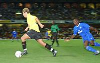 Lee Cook (Watford) ghosts past Geremi (Chelsea) Watford v Chelsea, Pre-Season Friendly, 5/08/2003. Credit: Colorsport / Matthew Impey DIGITAL FILE ONLY