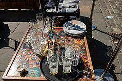 Pictured: There will always be washing up to do!<br /><br />The sun shone on Edinburgh's High Street as entertainers were plying their trade<br /><br />Ger Harley | EEm 10 August 2021