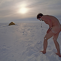 Arctic Ocean, Northwest Territories, Canada.A Russian expedition member takes his daily snow bath in camp.