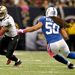 October 23, 2011; New Orleans, LA, USA; New Orleans Saints running back Pierre Thomas (23) is pursued by Indianapolis Colts linebacker Philip Wheeler (50) during the third quarter of a game at the Mercedes-Benz Superdome. The Saints defeated the Colts 62-7. Mandatory Credit: Derick E. Hingle-US PRESSWIRE / © Derick E. Hingle 2011