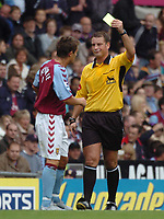 Credit: Back Page Images. Aston Villa v Crystal Palace, FA Premiership, 25/09/2004. Lee Hendrie (Aston Villa) is booked by referee Mark Clattenburg for over celebrating his goal
