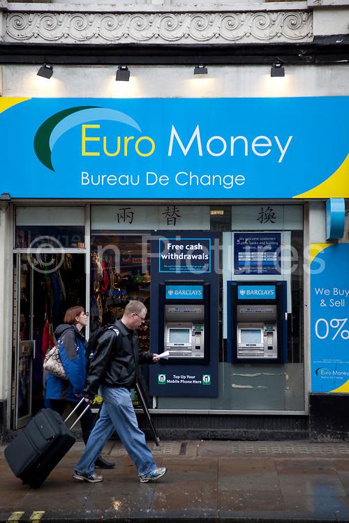 Euro Money Bureau de Change kiosk and cash point ATM machines. London.