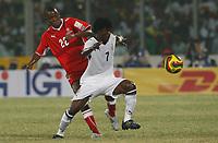 Photo: Steve Bond/Richard Lane Photography.<br />Ghana v Namibia. Africa Cup of Nations. 24/01/2008. Laryea Kingston (R) skips past Jamunovamdu Ngatjizeko (L)