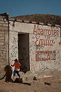 A young girl plays in the slums of Anarba, one of the poorest slums of Juarez, where a ready supply of gang members fuel the ongoing drug war in  Mexico January 15, 2009. The drug war has already claimed more than 40 people since the start of the year. More than 1600 people were killed in Juarez in 2008, making Juarez the most violent city in Mexico.    (Photo by Richard Ellis)