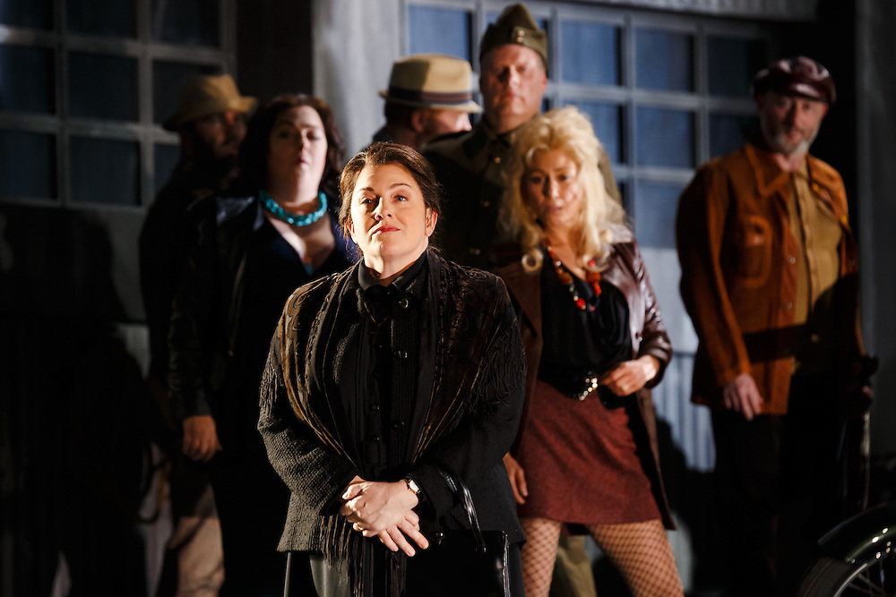 """LONDON, UK, 21 June, 2016. Foreground: Michaela Martens (as Kostelnicka Buryja) rehearses with members of the cast for the revival of director David Alden's production of Janacek's opera """"Jenufa"""" at the London Coliseum for the English National Opera. The production opens on 23 June. Photo credit: Scott Rylander."""