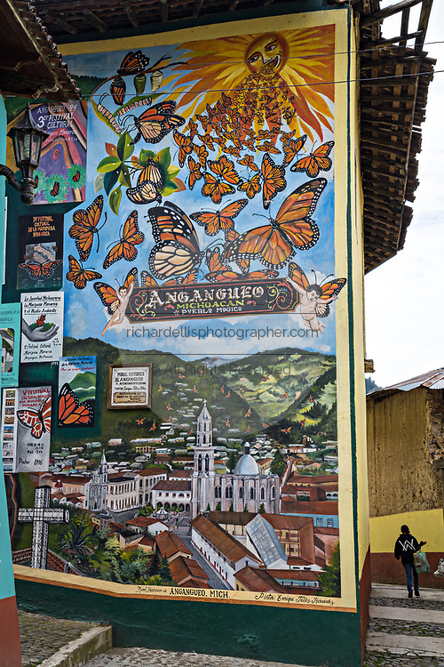 A mural painted on a building celebrating the Monarch Butterfly Migration in Angangueo, Michoacan, Mexico. Angangueo is a tiny, remote mountain town and the entry point to the Sierra Chincua Monarch Butterfly Sanctuary.