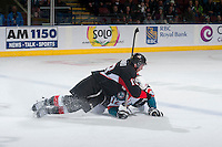 KELOWNA, CANADA - JANUARY 3: Zach Pochiro #13 of Prince George Cougars checks Tyrell Goulbourne #12 of Kelowna Rockets to the ice on January 3, 2015 at Prospera Place in Kelowna, British Columbia, Canada.  (Photo by Marissa Baecker/Shoot the Breeze)  *** Local Caption *** Zach Pochiro; Tyrell Goulbourne;