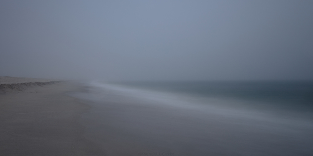 A panoramic view of the transition from land to sea at Surfside.