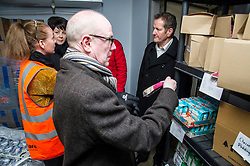 Pictured: Kevin Stewart inspects the sell-by date of produce in the cold store as Lynne Corrie, Depot manager explains how things operate to Elene Whitham and Jon Sparkes<br /> <br /> Today, Communities Secretary Aileen Campbell was joined by Councillor Elena Whitham, Cosla Community Wellbeing Spokesperson, Kevin Stewart, Minister for Local Government, Housing and Planning and Jon Sparkes Chief Executive of Crisis as she visited Cyrenians' Good Food depot where she met staff at the depot and toured the facility which redistributes surplus food to not-for-profit organisations. <br /> <br /> Ger Harley | EEm 27 November 2018