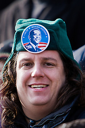 Man in green hat watching inauguration of Barack Obama from front steps of Lincoln Memorial, Washington D.C., USA.