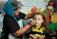 Middletown, New York  - A volunteer decorates a girl's face during the Middletown YMCA Family Fall Festival on Oct. 29, 2011. ©Tom Bushey / The Image Works