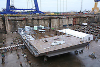 Royal Caribbean International 'Project Genesis' keel laying ceremony in Turku, Finland....The worlds largest cruise ship, currently known as Project Genesis ,  has it's first segment layed in dry Dock in Turku Finland today. The ship is due to be compleated in autumn 2009 and will be 40% bigger than the current world largest cruise ship also owned by Royal Caribbean International...
