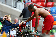 Daniel Sturridge of Liverpool passes his shirt to a young fan after the game. Premier League match, Liverpool v Burnley at the Anfield stadium in Liverpool, Merseyside on Saturday 16th September 2017.<br /> pic by Chris Stading, Andrew Orchard sports photography.