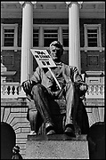 "Madison, WI - March 1970. On March 15, 1970, the University of Wisconsin - Madison Teaching Assistants' Association voted to strike, and the campus was filled with picket lines as well as demonstrations of related and other issues. The strike lasted until early April, when the Association and University came to an agreement. The statue of Abraham Lincoln in front of Bascom Hall with a sign that reads ""TAA on strike against UW."""