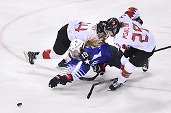 February 22, 2018 - Pyeongchang, South Korea - USA's GIGI MARVIN is taken down by Canada'€™s RENATA FAST and MARIE-PHILIP POULIN in the first period of the Women's Gold Medal Ice Hockey game Thursday, February 22, 2018 at Gangneung Hockey Centre at the Pyeongchang Winter Olympic Games. Photo by Mark Reis, ZUMA Press/The Gazette (Credit Image: © Mark Reis via ZUMA Wire)