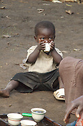 Africa, Ethiopia, Jinka, young boy of three Drinking the morning coffee