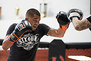 UFC featherweight Anthony Pettis of Wisconsin hits mitts with striking coach Brandon Gibson at Jackson Wink MMA in Albuquerque, New Mexico on June 9, 2016.