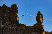 Visitors fly paragliders in a scenic area outside of Monument Valley.