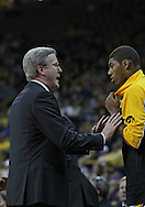 December 07 2010: Iowa head coach Fran McCaffery talks with Iowa Hawkeyes guard/forward Roy Devyn Marble (4) during the first half of their NCAA basketball game at Carver-Hawkeye Arena in Iowa City, Iowa on December 7, 2010. Iowa defeated Northern Iowa 51-39.