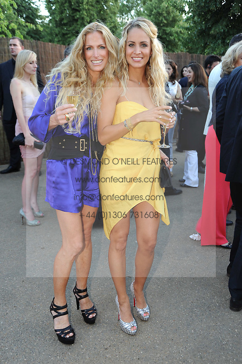 Left to right, LAURA COMFORT and OLIVIA STEELE at the annual Serpentine Gallery Summer party this year sponsored by Jaguar held at the Serpentine Gallery, Kensington Gardens, London on 8th July 2010.  2010 marks the 40th anniversary of the Serpentine Gallery and the 10th Pavilion.