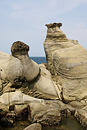 """Keelung, Taiwan has some beautiful geology in its Hoping Coastal Park,  Here, sandstone is being slowly eroded away leaving """"mushroom rock"""" formations."""