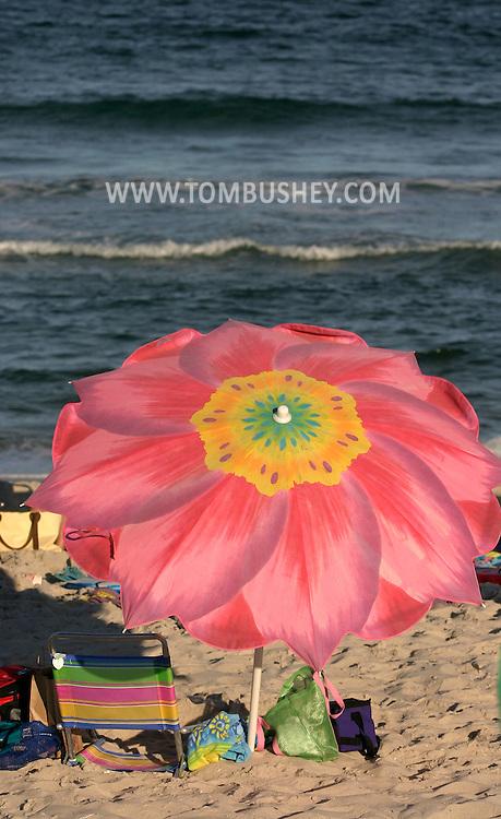 A colorful umbrella on the beach on a summer afternoon at Spray Beach on Long Beach Island, N.J..Aug. 25, 2005........