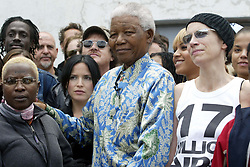 Nov 28, 2003; Cape Town, SOUTH AFRICA; NELSON MANDELA with ANGELIQUE KIDJO (L) & ANNIE LENNOX (R) before the 46664 'Give 1 Minute of Your Life to Stop AIDS' benefit concert in Cape Town, organized by Mandela. (Credit Image: © 378/ZBP/ZUMAPRESS.com)
