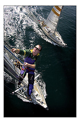 The Clipper Around the World Race 2000..Watch Leader Ross Drummond inspects the mast as the boat nears the finish.. .Marc Turner / PFM.www.pfmpictures.co.uk