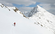 A walker heads towards Lliwedd, Snowdon, North Wales, after the heaviest spring snow for many years