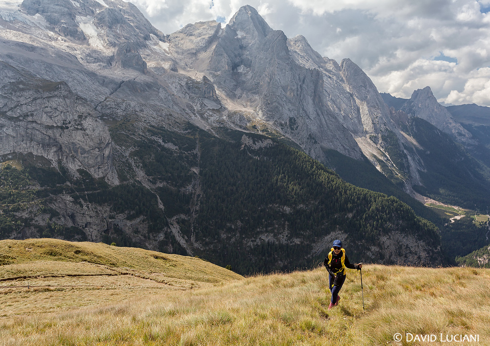 Walking on Bindelweg with view on Marmolada glacier. The hike across the Viel del Pan can easily be made in one day.