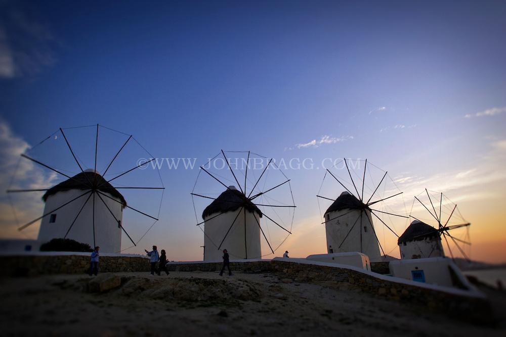 Windmills at sunset, Mykonos, Greece.